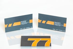 Two business cards on a white background.