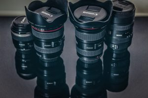 Image of camera lenses signifying photography.