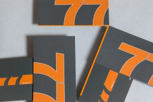 77Design Co logo and business cards.