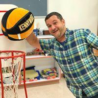 Rob playing basketball and slam dunking.