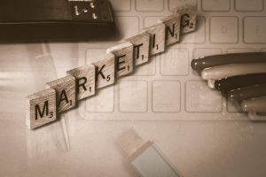 Some benefits to blogging. Image of scrabble pieces spelling marketing.
