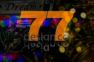Orange 77 Design Co logo and Christmas tree. Holidays in 2020.
