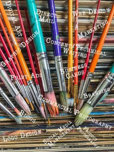 Using creativity in marketing. Photograph of multi colored paint brushes and records.